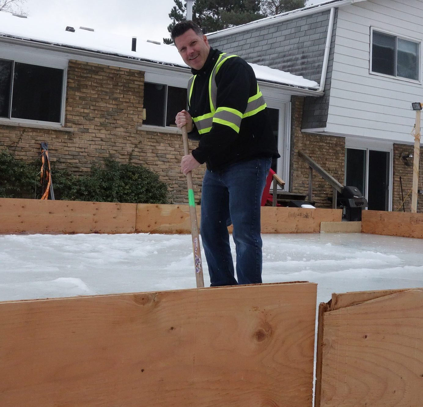 Keith has made the boards of the DIY backyard ice rink very safe.