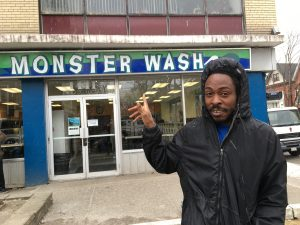 Sheldon in Parkdale in front of Monster Wash, coin laundry business, economic recession