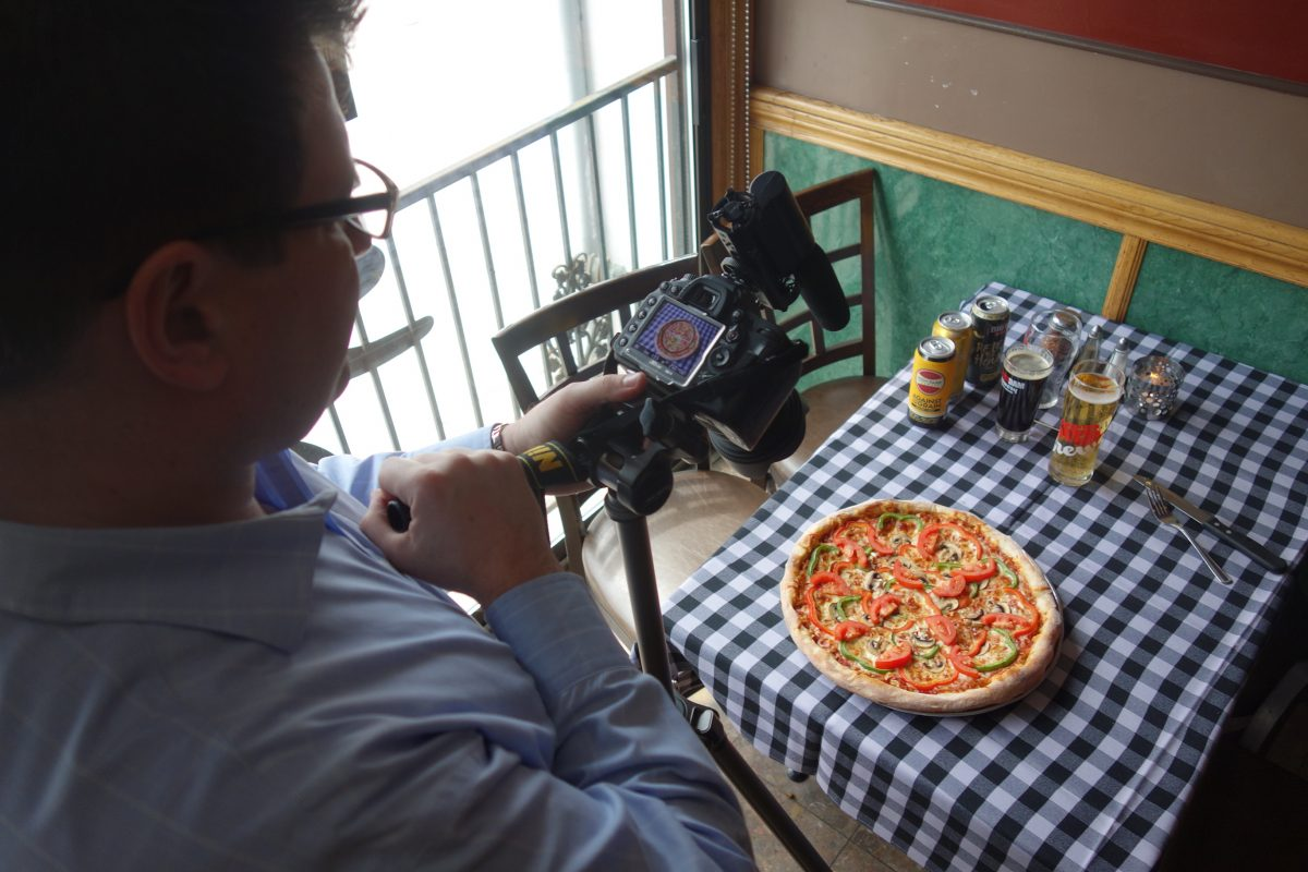 Markus from Dina Palace shoots Amico's perfect pizza p[ies