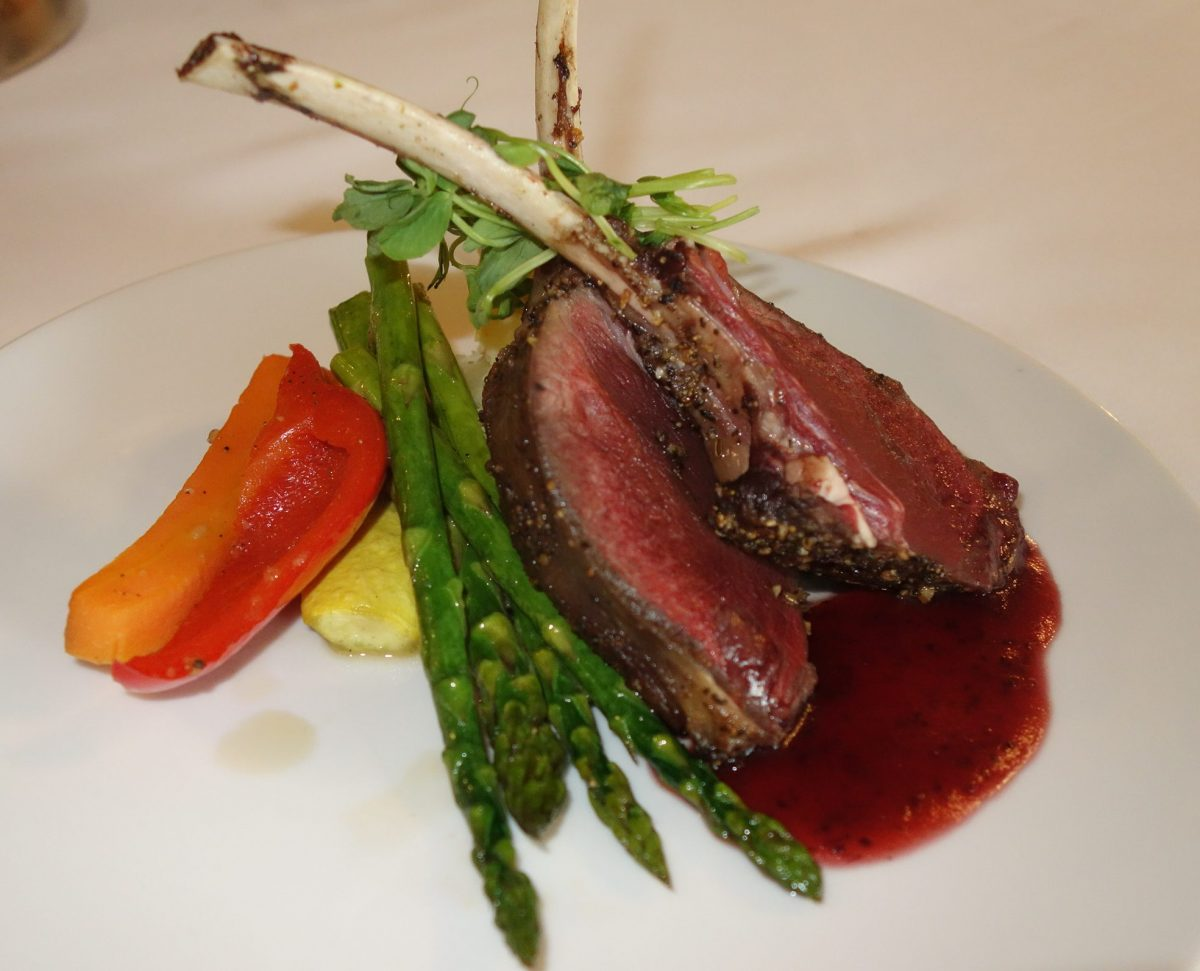 Venison in cranberry sauce with roasted peppers and asparagus