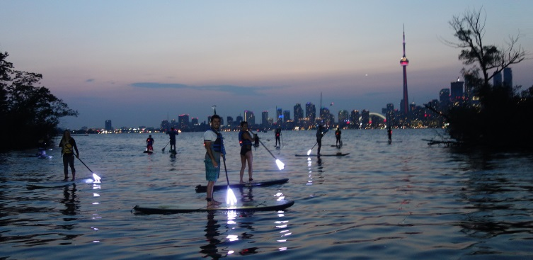 paddleboarding in Toronto harbour at night