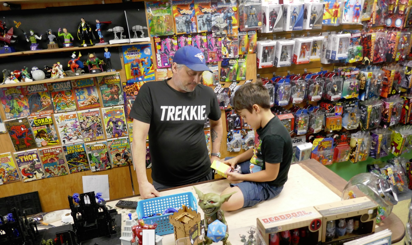 Trekkie in the comic shop with his son