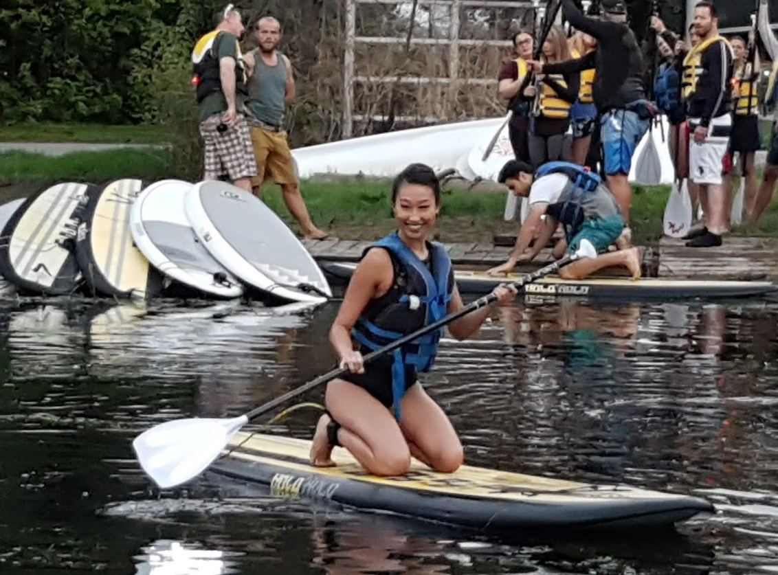 Alice Li getting accostomed to her Stand Up Paddleboard in Toronto