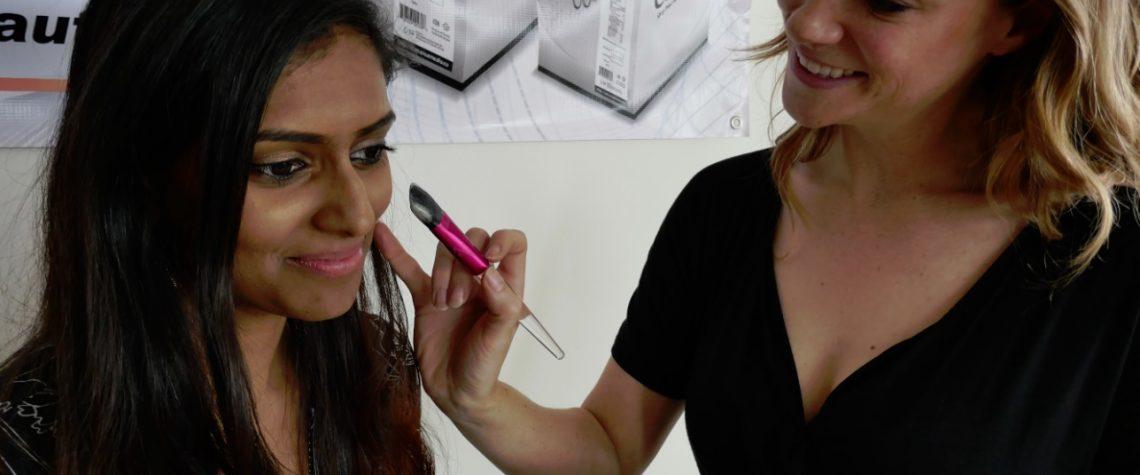 Christinja Paruag gets an egg whiote powder beauty mask from Jen Turner of Modern Makeup